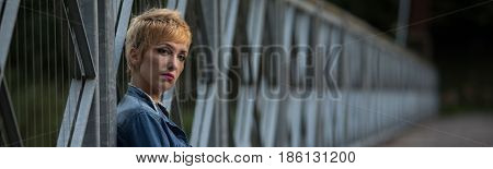 Dark Moody Panorama Of A Serious Blond Woman