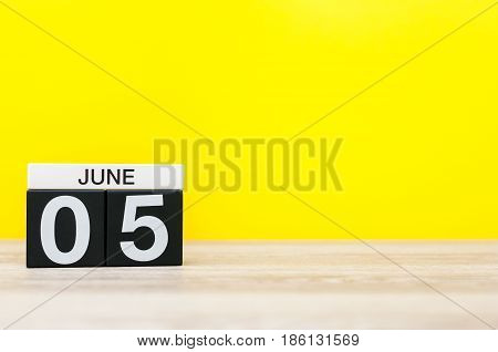 June 5th. Day 5 of month, calendar on yellow background. Summer day, empty space for text. International Cleanup Day.