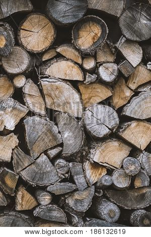 A Pile Of Stacked Firewood. Preparation For Winter Season. Background