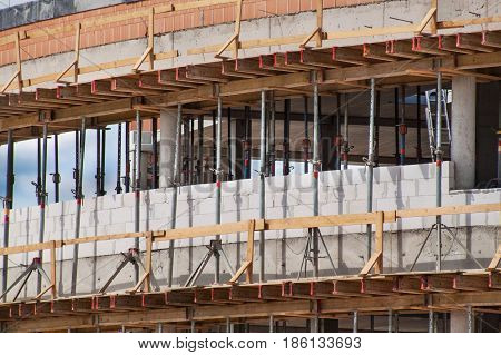 Scaffolding and concrete formwork. Building site of an office building. Construction works