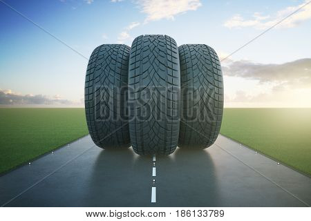 Front view of three tires in the middle of road. Bright sky background. Transportation concept. 3D Rendering