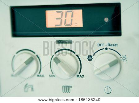 House gas heater control clocks close up
