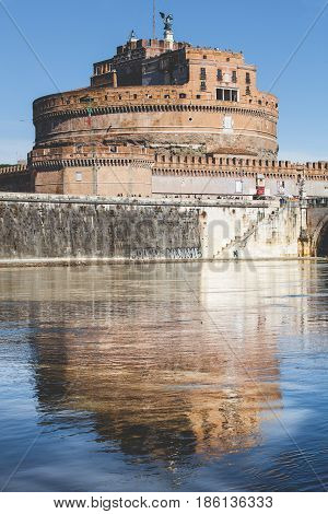 ROME, ITALY. March 11, 2016: Mausoleum of Hadrian and reflection on Tiber river in Rome, Italy. Daytime with blue sky.