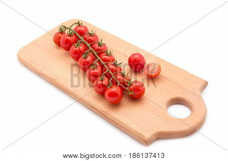 Tomatoes. Cherry tomatoes. Cocktail tomatoes on wooden board.
