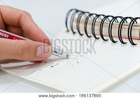 pencil eraser pencil eraser removing a written mistake on a piece of paper delete correct and mistake concept.