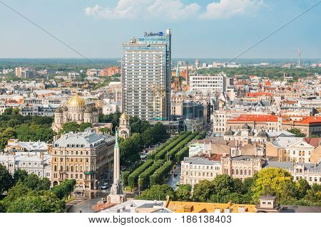 Riga, Latvia - July 1, 2016:  Cityscape In Sunny Summer Day. Top View Of Famous Landmarks - Riga Nativity Of Christ Cathedral, Memorial Freedom Monument And Freedom Boulevard Street.