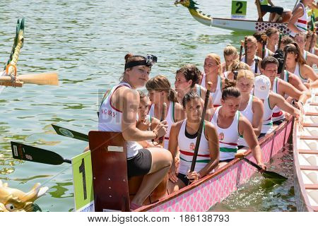 Rome Italy - July 30 2016: Dragon boat crews compete at the european championships held in Italy in 2016 summer in the photo a girl of the Hungary crew is smiling after race