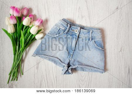 Short Denim Shorts With Rhinestones, Pink Tulips. Fashionable Concept, Top View