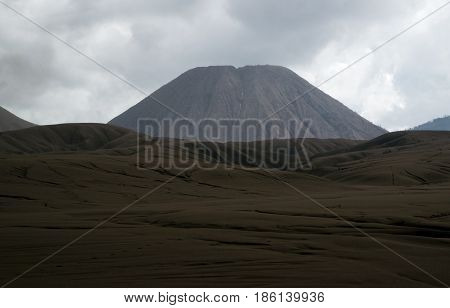 Brown Sandy Foot Of Mount Batok Early In The Afternoon At The Tengger Semeru National Park In East J