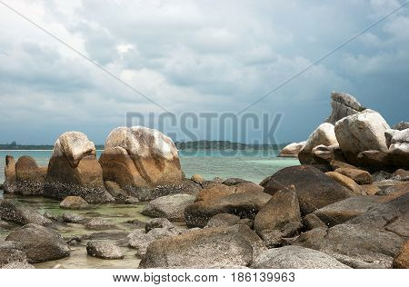 Natural rock formation on coast in Belitung Island in the afternoon Indonesia.