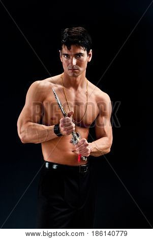 The hot sexy warrior is about to pull out his weapon.