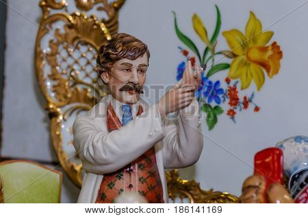 Moscow, Russia - March 19, 2017: Closeup vintage collection porcelain figurine of the doctor of the Victorian era at the fair of antique hobby items