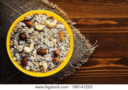 Muesli With Nuts(hazelnuts, Cashews, Almonds). Muesli On A Wooden Table. Muesli Top View . Healthy F