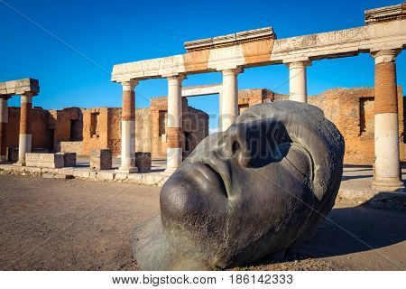 Scenic View Of Ruins And Bronze Statue In Ancient Pompeii City