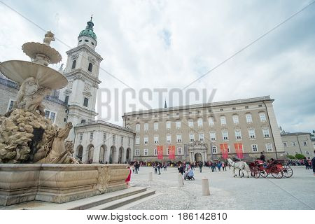 Salzburg, Austria - 14 April 2017 : People Around Residenzplatz, The Large, Stately Square In The He