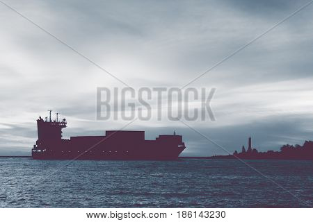 Large container ship silhouette arriving from Baltic sea