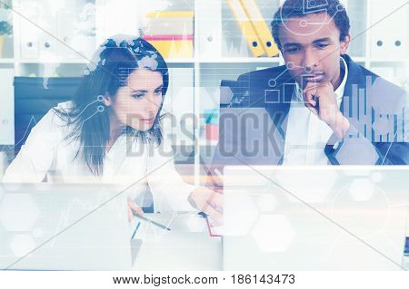 Front view of an African American businessman and his colleague sitting at an office table. Toned image double exposure.