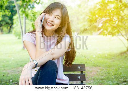 Businesss Smiling Women Talking On Cellphone In Park