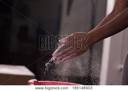 Gym Chalk Magnesium Carbonate hands clapping young african american woman for climbing workout
