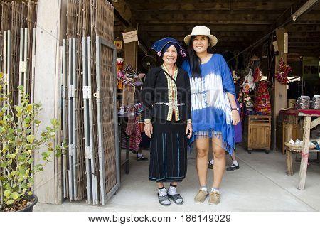 Thai Women Travelers Take Photo With Tai Dam Senior People Wear Costume Traditional At Tai Dam Ethni