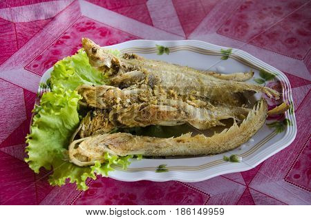 Fried Sheatfishes Or Siluridae Fresh River Fish With Garlic And Pepper Severe With Vegetable