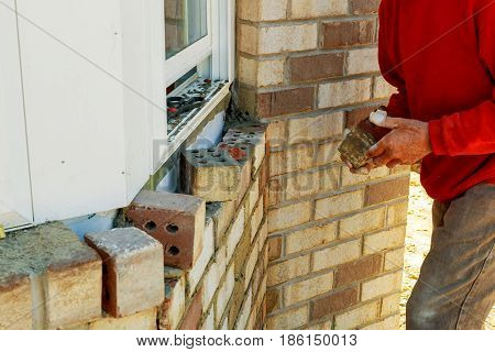worker a decorative brick Facing wall decorative tiles, workers in blue glove