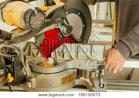 wood and sawing machine construction ideas concept Circular Saw. Cutting a wooden plank