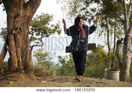Travelers Thai Woman Posing And Playing Swing Toy For Take Photo At Viewpoint On Top Of Phu Tok Moun