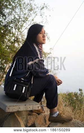 Travelers Thai Woman Sit And Posing For Take Photo At Viewpoint On Top Of Phu Tok Mountain