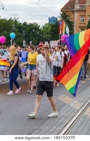 ZAGREB, CROATIA - JUNE 11, 2016: 15th Zagreb pride. LGBTIQ activist holding flag.