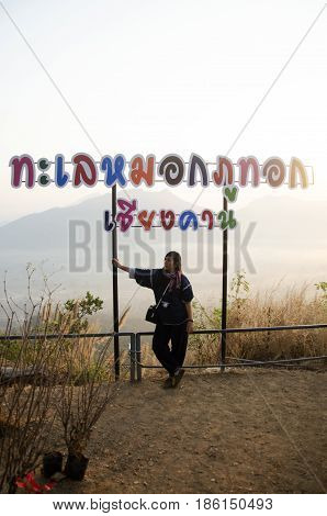 Travelers Thai Woman Looking View And Posing At Viewpoint On Top Of Phu Tok Mountain