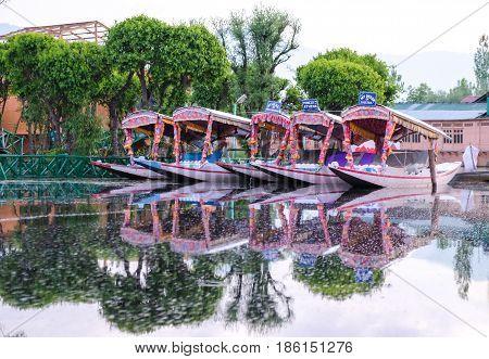 Srinagar India - 25 April 2017 : Shikara a small boat People use for transportation in the Dal lake of Srinagar Jammu and Kashmir state India.