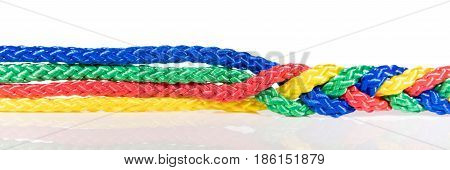 Panorama colorful ropes are connected concept cooperation and cohesion