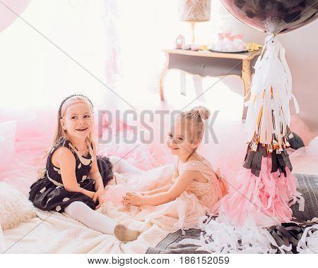 Beautiful little girls celebrating birthday party. Family celebration of the child