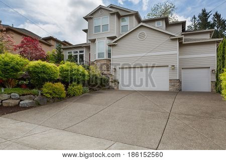 House in North American suburban residential neighborhood two storey with 3 car garage