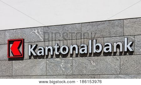 Einsiedeln, Switzerland - 7 September, 2015: sign on the wall of an office of the Cantonal Bank of Schwyz. Cantonal banks are commercial banks which are provided with a guarantee for the assets held there by the Swiss canton in which they are based.