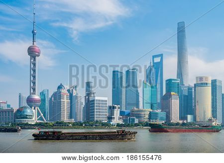 Shanghai, China - Nov 4, 2016: Close view of the Shanghai City skyline shrouded in some afternoon haze. Features the iconic Oriental Pearl TV tower and Huangpu River.