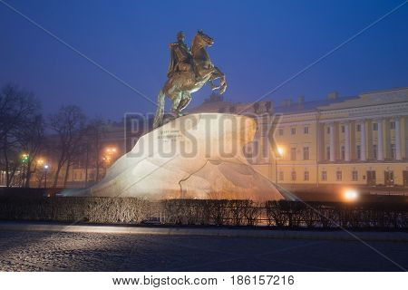 View of the old monument to Peter the Great (Bronze Horseman, 1872) in a misty mystical night. Saint-Petersburg Russia