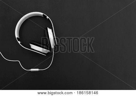 Headphone . headphone on wood table. White headphone and black background. selective focus of headphone.