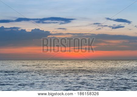 Sunset over seacoast skyline nautral abstract background