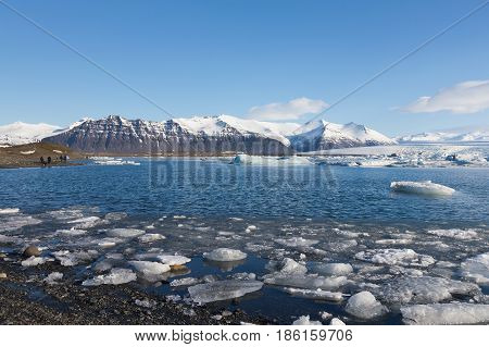 Jokulsarlon winter lagoon with mountain background Iceland natural landscape background