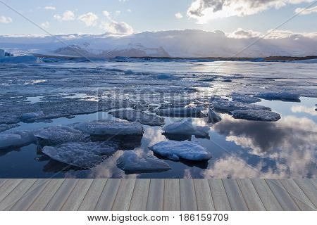 Opening wooden floor Beauty Jokulsarlon lake iceberg lagoon Southeast of Iceland natural landscape background