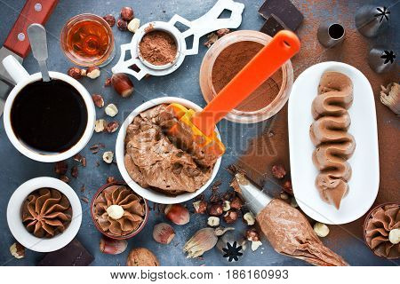 Assortment of chocolate products for cooking delicious chocolate cream with hazelnut cocoa coffee and cognac