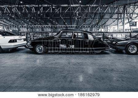 STUTTGART GERMANY - MARCH 02 2017: Mid-size luxury car Citroen DS23 Pallas 1973. Stylization. Toning. Europe's greatest classic car exhibition