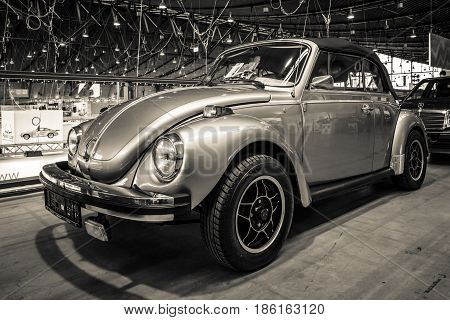 STUTTGART GERMANY - MARCH 02 2017: Subcompact car Volkswagen Beetle Cabrio 1973. Sepia toning. Europe's greatest classic car exhibition