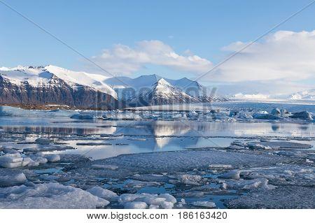 Jokulsarlon blue ice lagoon. Iceland winter season natural landscape background