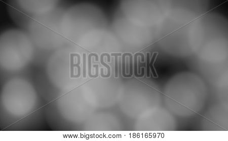 black background with white gray or light spots in a chaotic manner