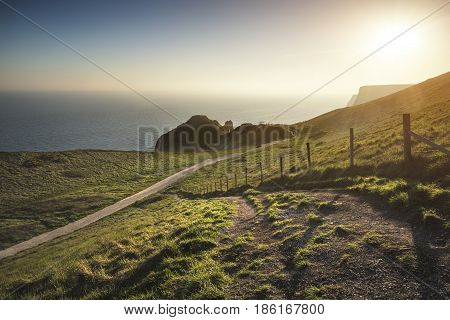 Beautiful Sunset Landscape Image Of Durdle Door On Jurassic Coast In England