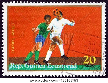 EQUATORIAL GUINEA - CIRCA 1977: a stamp printed in Equatorial Guinea shows Players in Action Soccer circa 1977