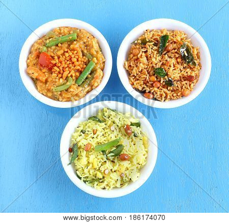 South Indian traditional and popular vegetarian rice dishes bisi bele bath, puliyogare and lemon rice.
